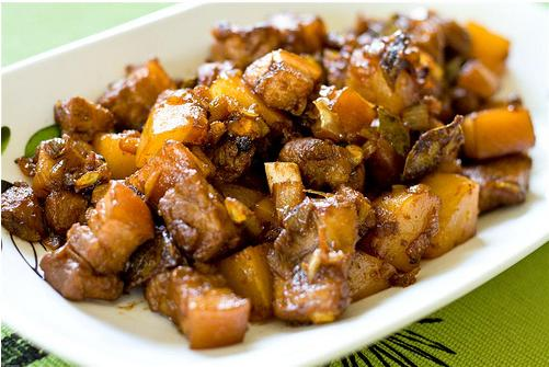 pork adobo with sweet potato on a plate