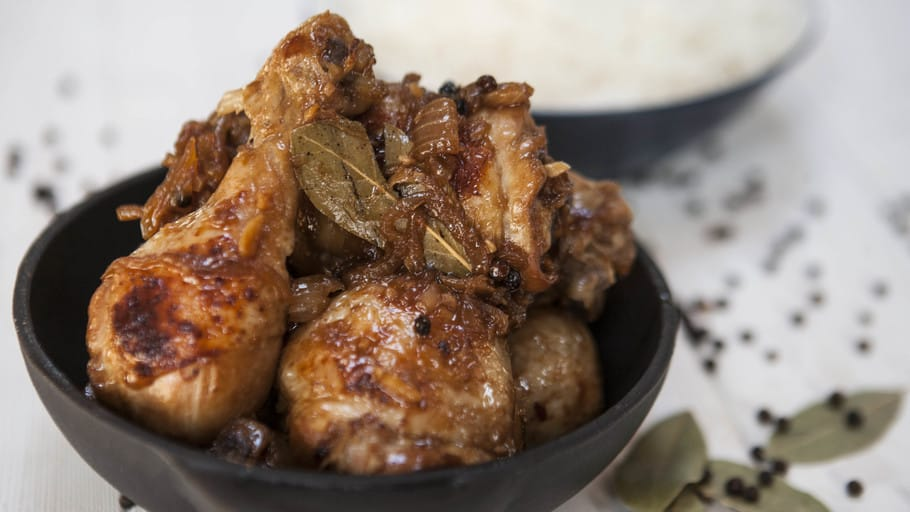 Chicken Adobo with sauce and laurel in a bowl