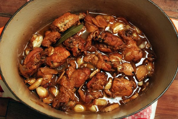 sauce of chicken adobo with garlic and laurel leaves