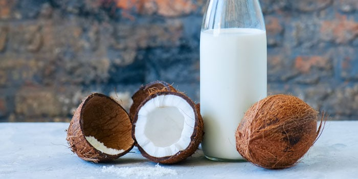coconut and coconut milk in a glass bottle
