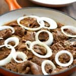 tasty beef steak with white onions
