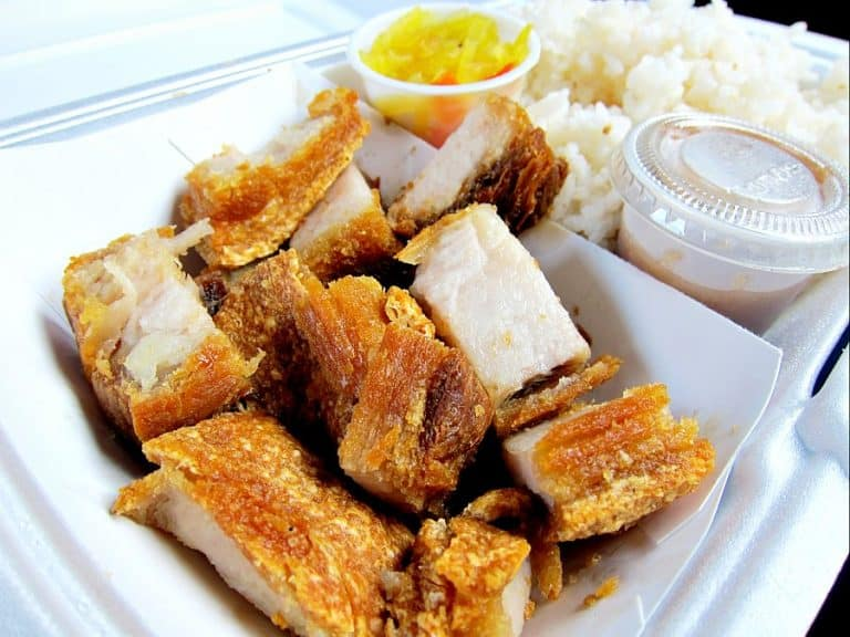 crispy lechon kawali in a food box with sauce