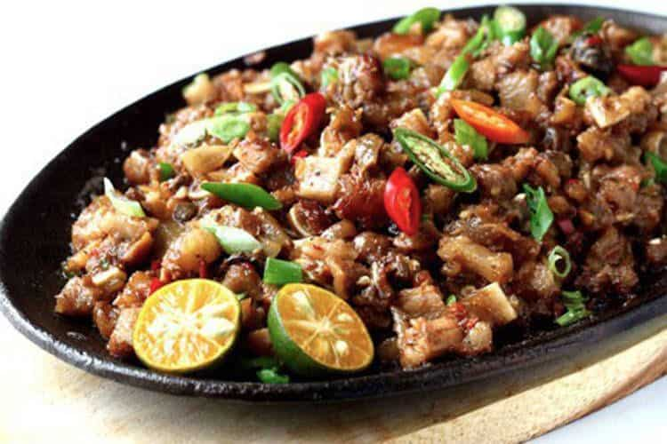 pork sisig on a sizzling plate