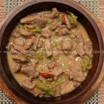 hot and spicy pork bicol express with red and green chilies in a bowl