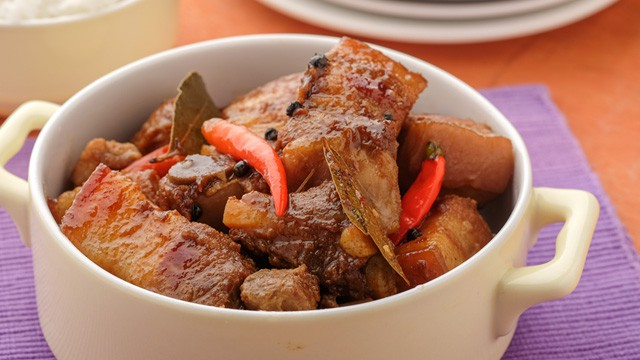delicious and spicy pork adobo with red chilies on top