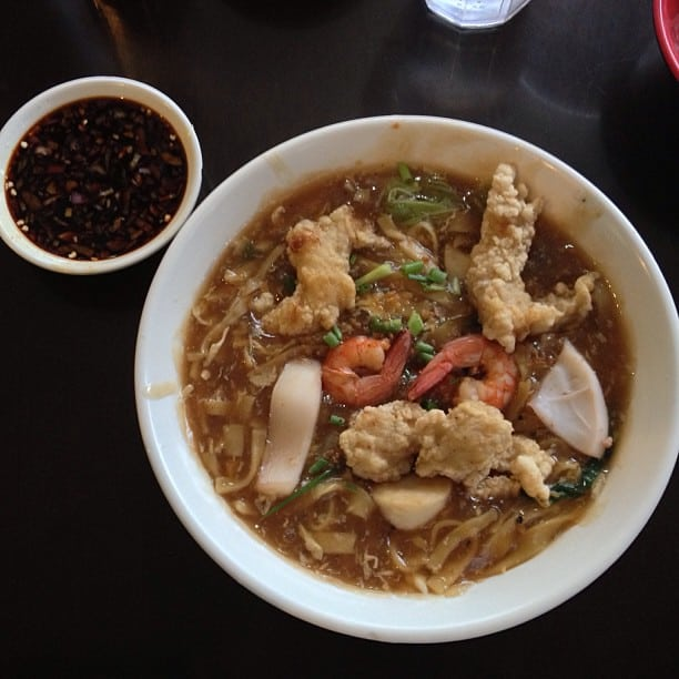 seafood lomi in a bowl side with sauce