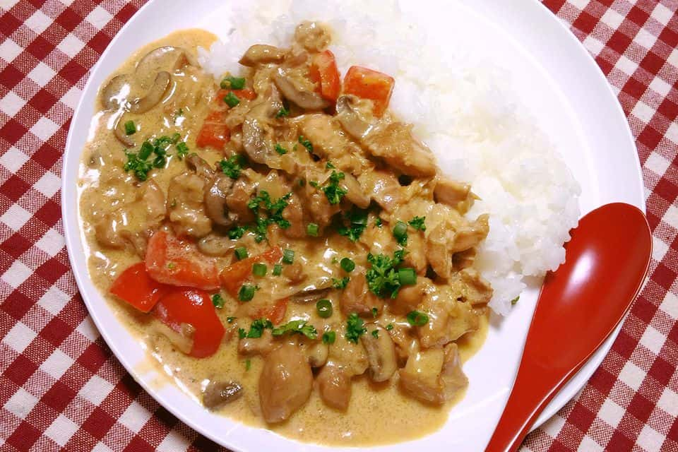chicken ala king with rice on the side