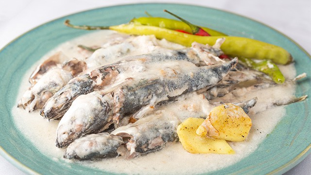 creamy ginataang galunggon with green chili and ginger in a plate