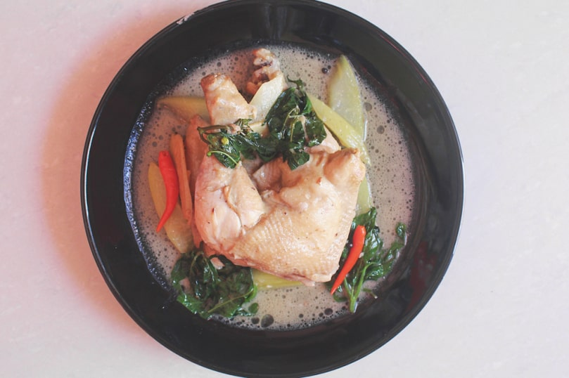 ginataang manok with spinach on a plate