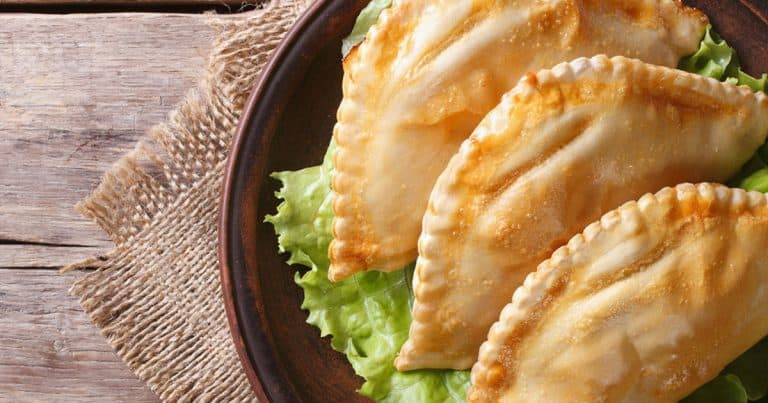 pork empanada in a plate with cabbage