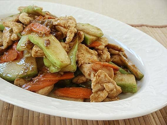 ginisang sayote with chicken on a wide plate
