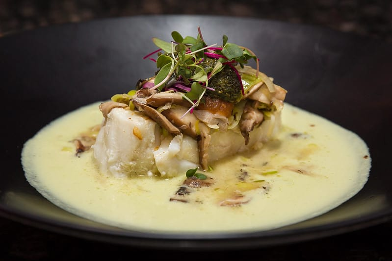 chilean sea bass on a large black bowl