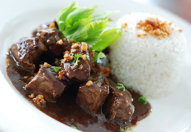 salpicao with rice on a plate