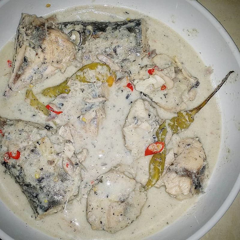 ginataang yellow fin on a bowl with green chili on top
