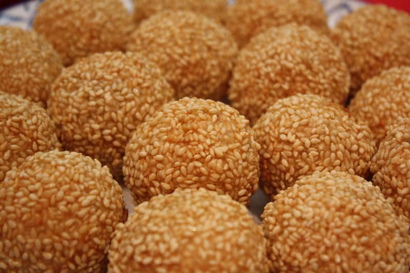 delicious golden brown buchi with sesame seeds