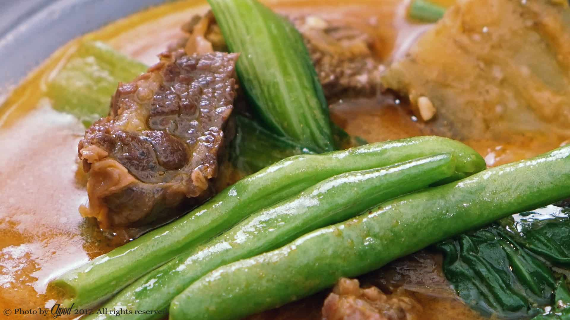 beef kare-kare with string beans on top