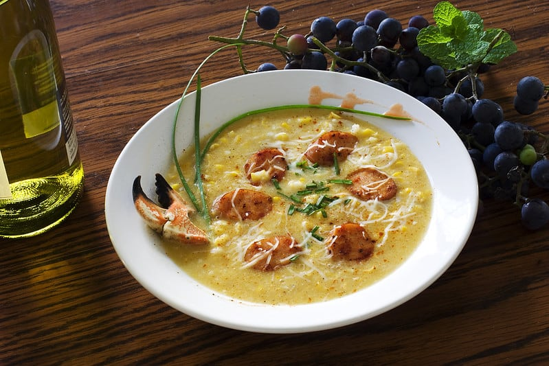 crab and corn chowder soup in a bowl with spoon