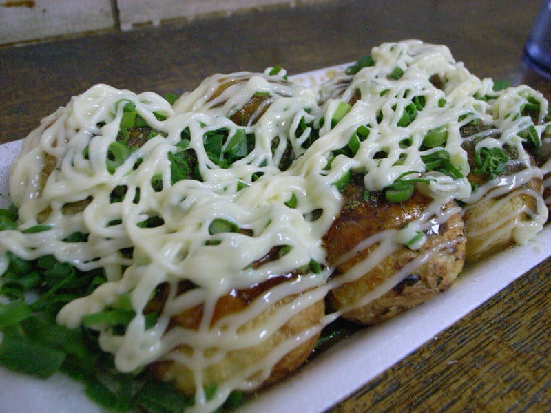 delicious takoyaki on a plate with sauce