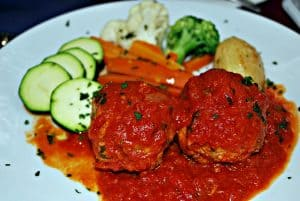 Italian meatballs with sauce side with fresh vegetables