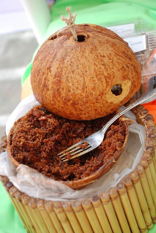 bukayo in a coconut shell with fork