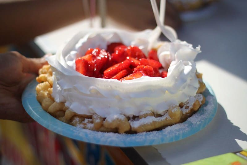 funnel cake with strawberries at the center