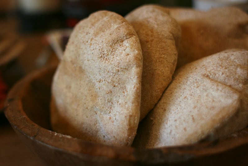 pita bread in a brown wooden bowl