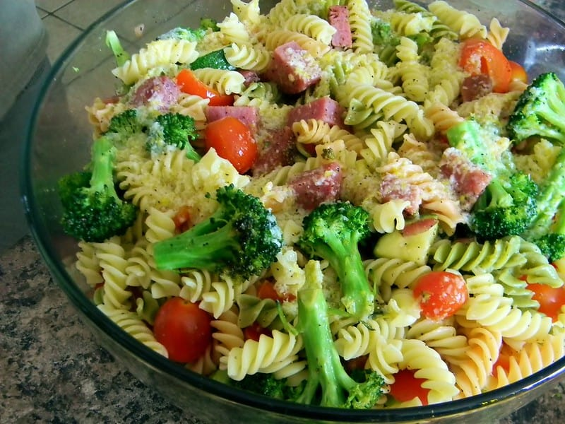creamy pasta salad in a transparent bowl