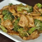 chicken and broccoli stir fry on a rectangular plate