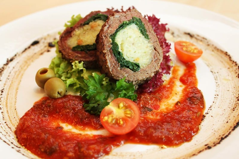 beef braciole on a plate with sauce