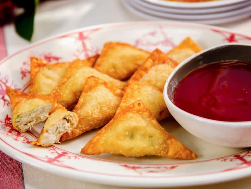 delicious crab rangoon in a plate with sauce