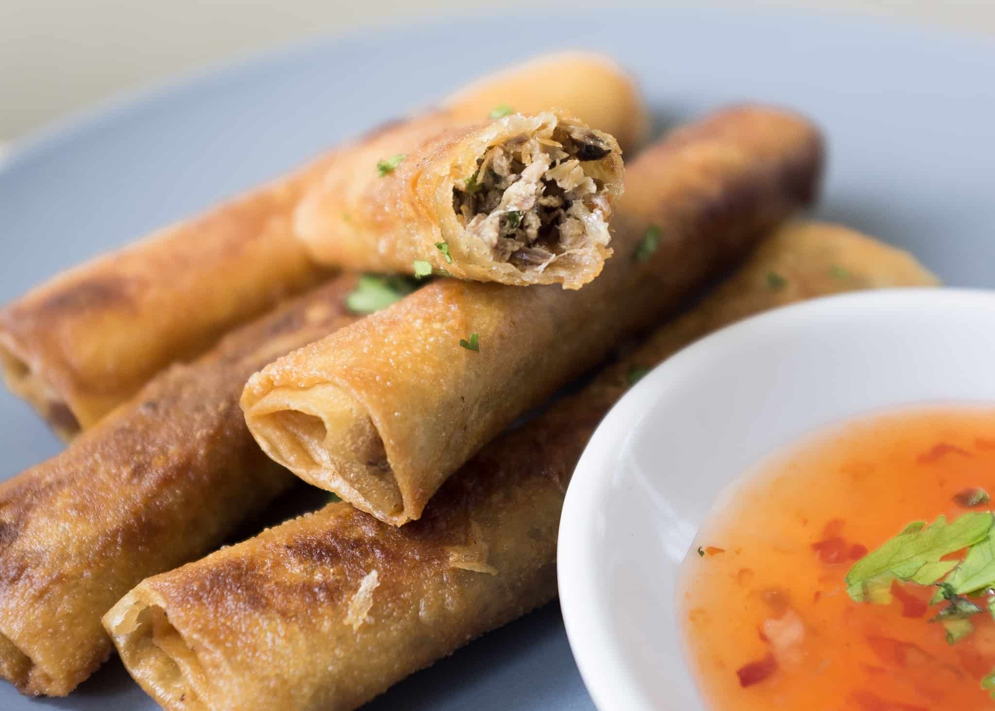 fish lumpia in a plate with sweet sauce