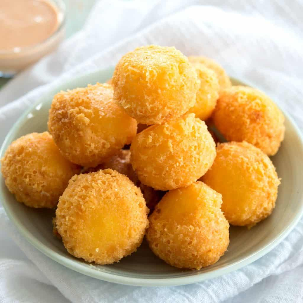 golden brown cheese balls in a bowl.