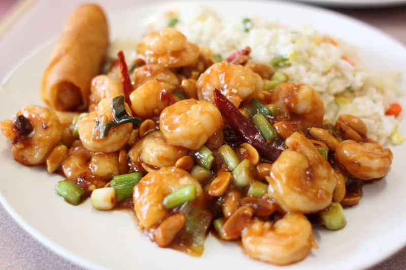 delicious kung pao shrimp with fried rice in a plate