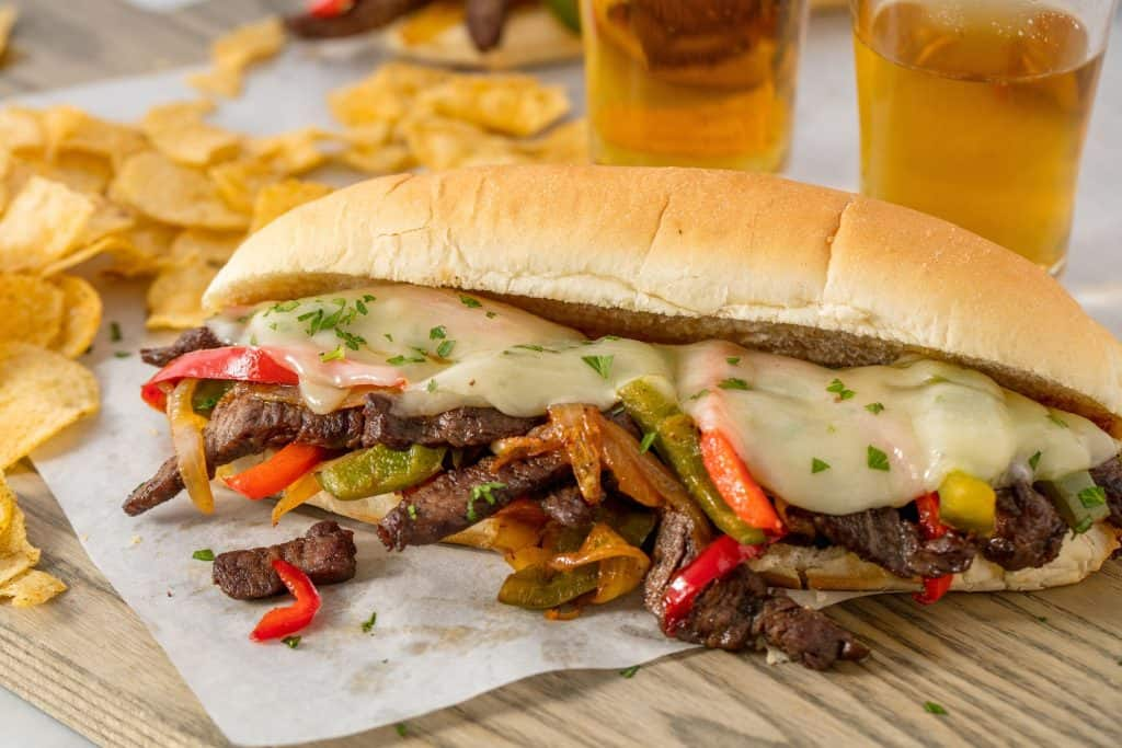 delicious philly cheesesteak on a wood chopping board