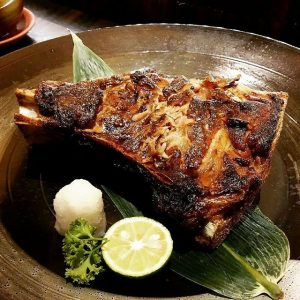 grilled tuna jaw with lime on the side