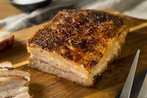 roasted pork belly on a chopping board