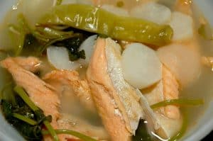 sinigang na salmon in a bowl