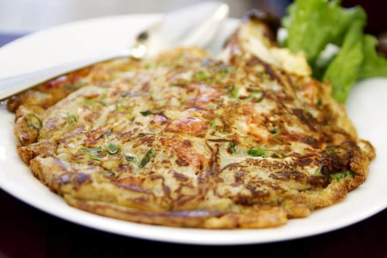 tortang talong with giniling on a white plate