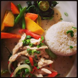 chicken bicol express on a plate with rice