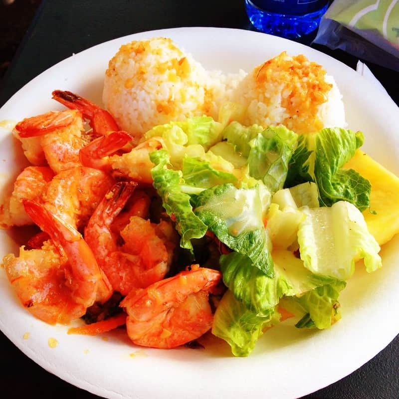 garlic butter shrimp with rice and vegetables on a plate