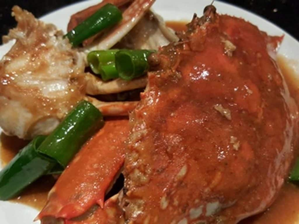chili crab with snake beans on a plate
